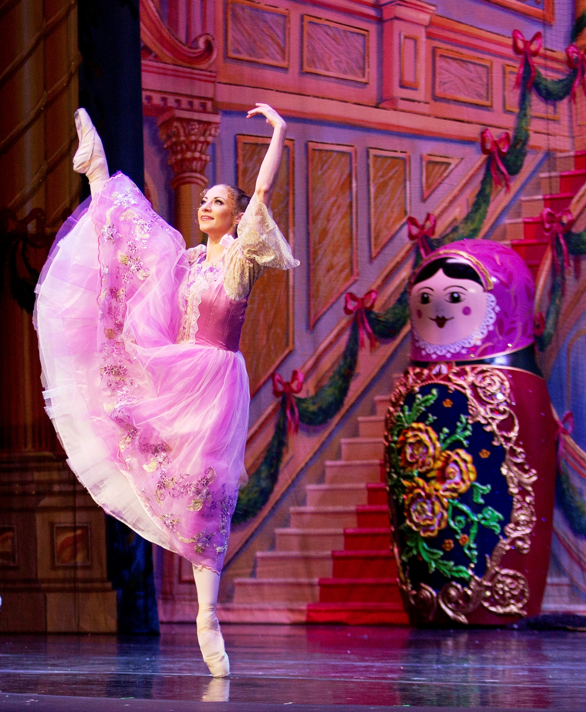 5. Moscow Ballet's Masha in high arabesque and oversized Nesting Doll