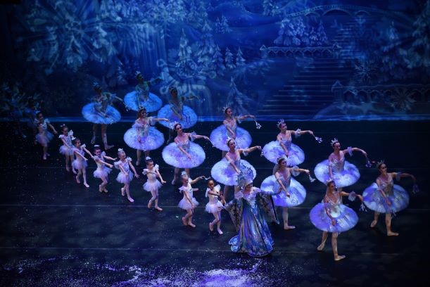 Little Snowflakes dance alongside the professional ballerinas in Waltz of the Snow Forest