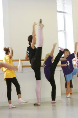 Moscow Ballet teacher and soloist Svetlana Todinova works with children in Durham NC